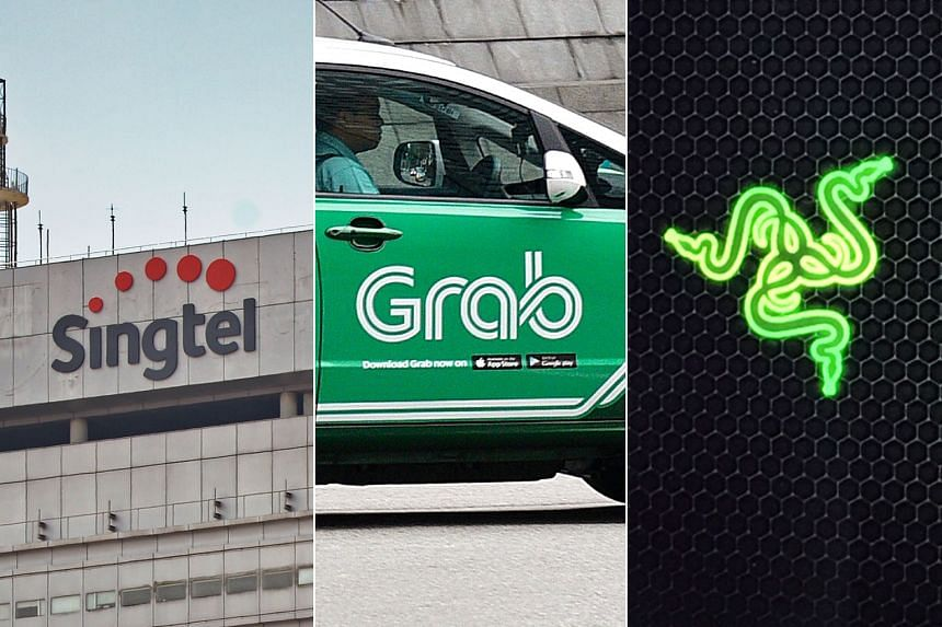 The logos of (from left) Singtel, Grab and Razer, that will be studying closely how a digital bank will complement their businesses.