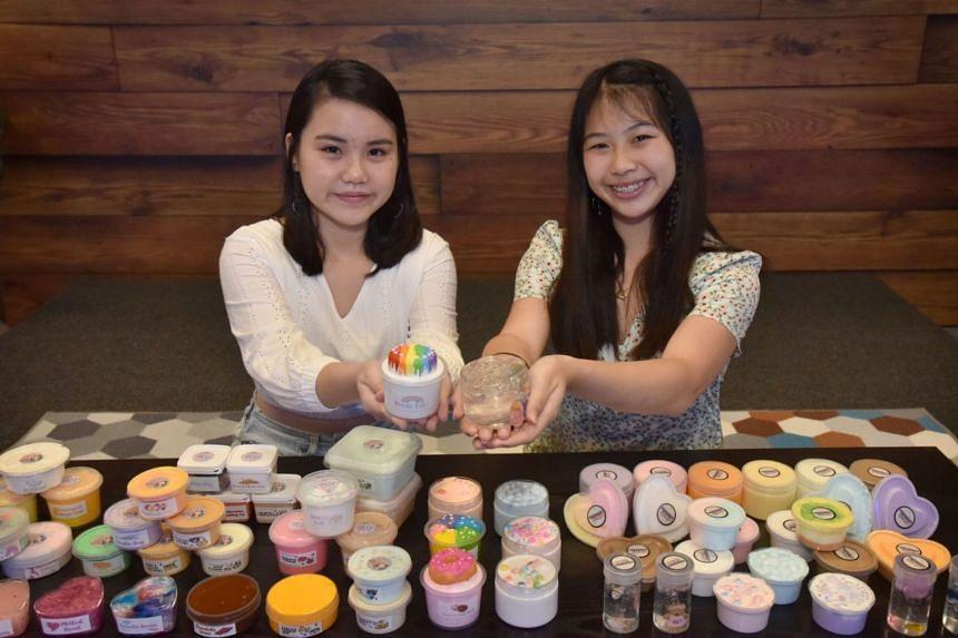 Ang Jia Xin (left) and Hannah Tan, who sell slimes for profit.