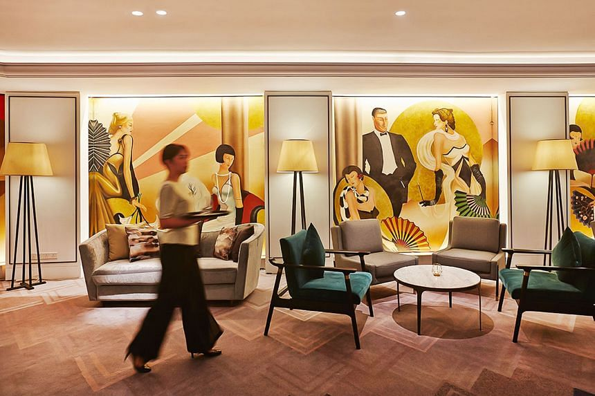 Orchard Hotel Singapore has undergone a multimillion-dollar facelift at various areas of the hotel, including its elevated lobby bar, Bar Intermezzo (right), and grand deluxe rooms (above).