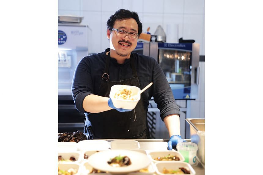 Mr Woo Wai Leong, chef-owner of Restaurant Ibid, with tasting portions of his dishes.
