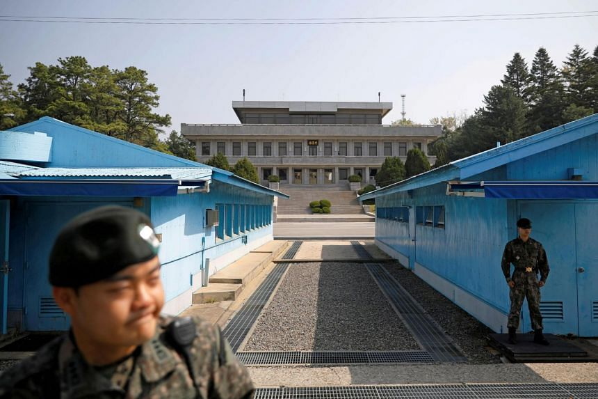 South Korean soldiers stand guard at the truce village of Panmunjom inside the demilitarised zone separating the two Koreas on May 1, 2019.