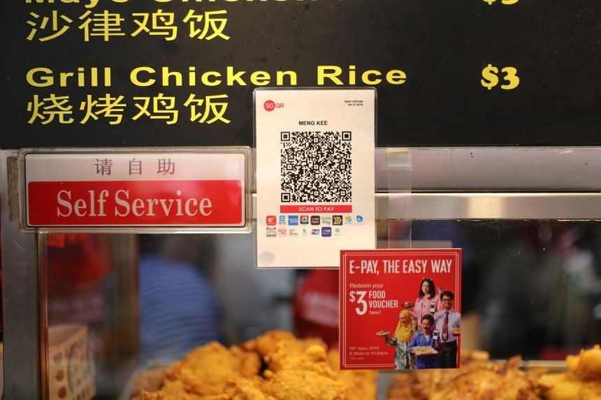 A hawker stall with the sticker displayed that shows it has adopted the unified e-payment solution at 628 Ang Mo Kio Ave 4.