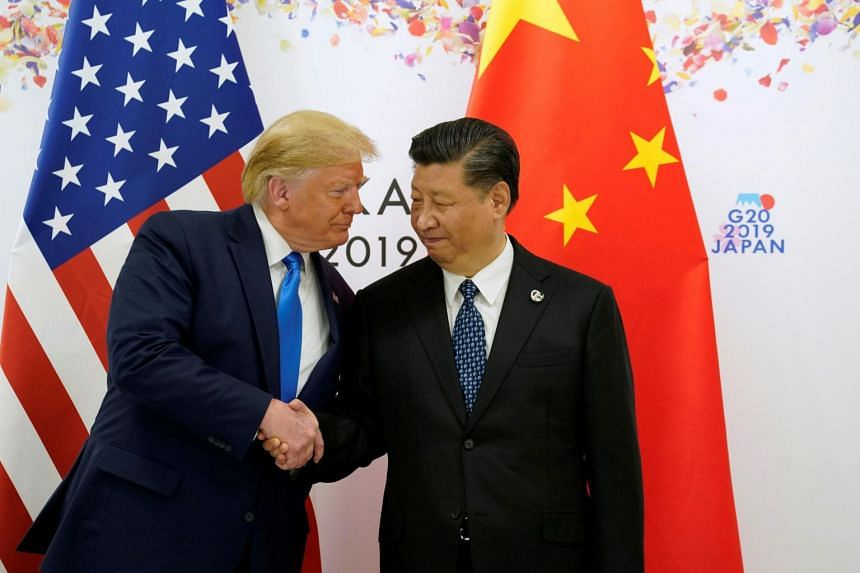US President Donald Trump shakes hands with China's President Xi Jinping before starting their bilateral meeting during the G-20 leaders summit in Osaka, Japan, on June 29, 2019.