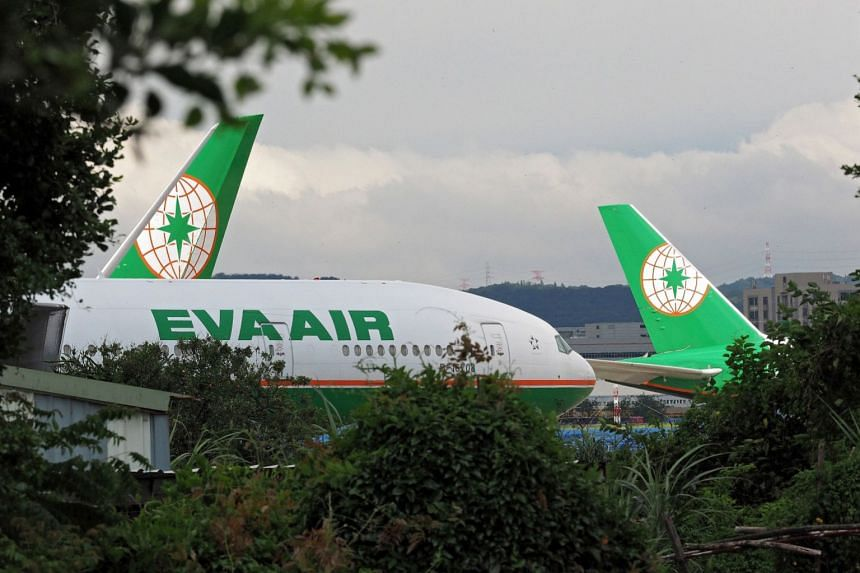 EVA Air planes are parked up due to a workers' strike at the Taoyuan International Airport in Taiwan.