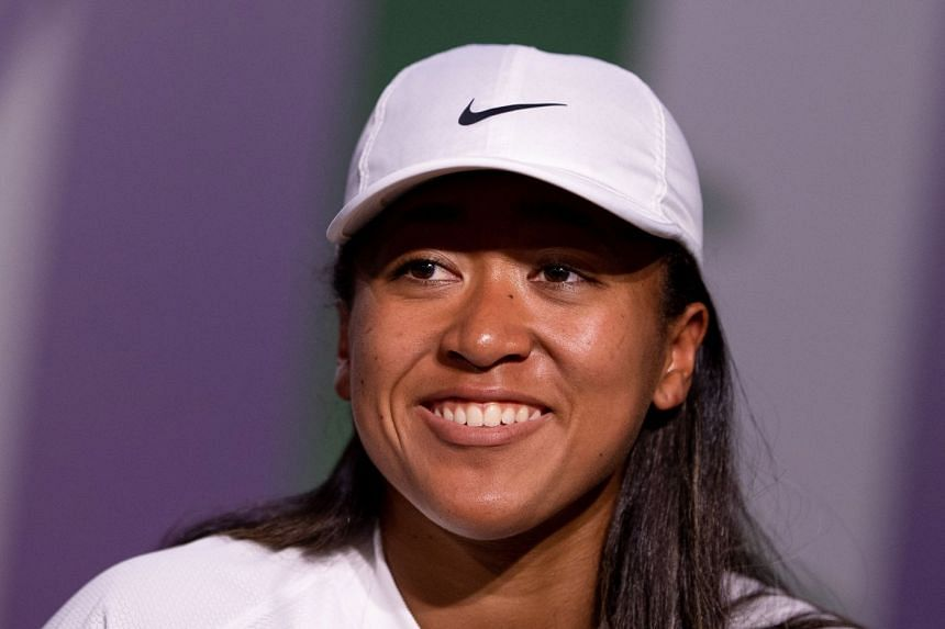 Osaka addresses the media during a pre-Wimbledon press conference.