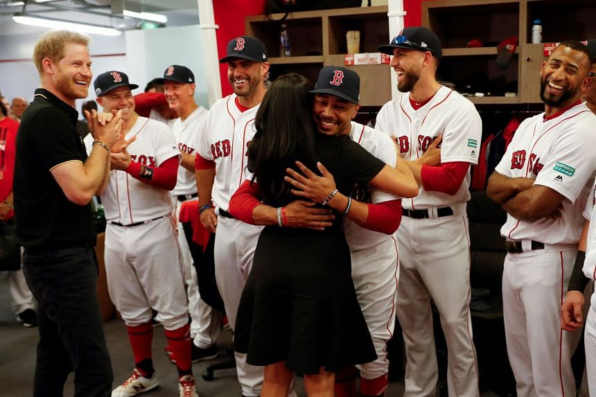 Harry and Meghan meet players of the Boston Red Sox before a match against the New York Yankees in London.