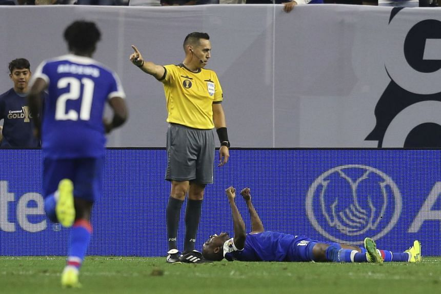 Midfielder Wilde-Donald Guerrier (on ground) celebrating after putting Haiti 3-2 up against Canada in their Gold Cup quarter-final at NRG Stadium.