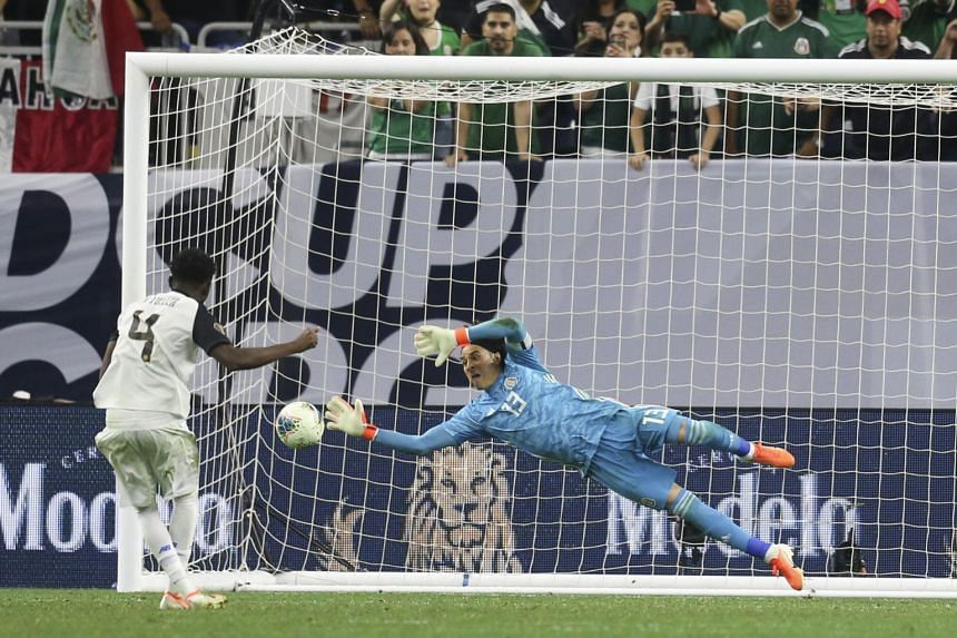 Goalkeeper Guillermo Ochoa saving a penalty in sudden death by Costa Rica defender Keysher Fuller at NRG Stadium, Houston to take Mexico into the Concacaf Gold Cup semi-finals.