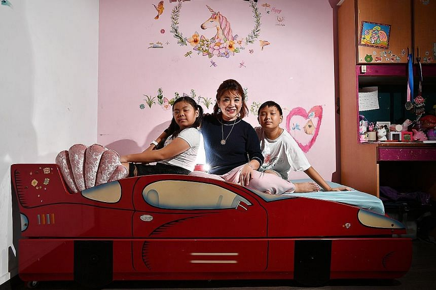 Ms Jodia Tay and her children Owen, 11, and Megan, 10, in Megan's bedroom at their home in The Clearwater in Bedok. Ms Tay bought the unit at the end of 2012 for $1.35 million and the family moved in after renovations were completed in 2013. She chose The