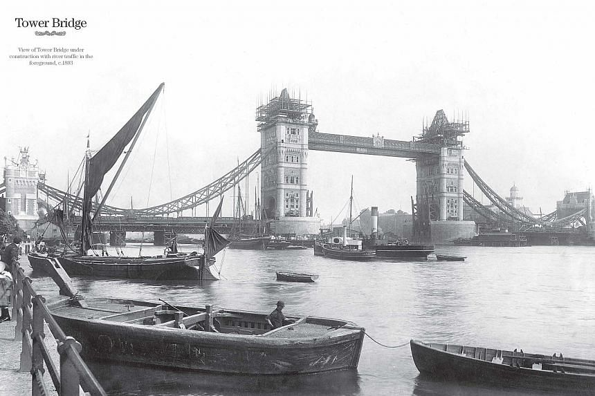 Then and now: London's Tower Bridge today (left) and under construction in 1893 (above), the year before its opening. PHOTOS: AGENCE FRANCE-PRESSE