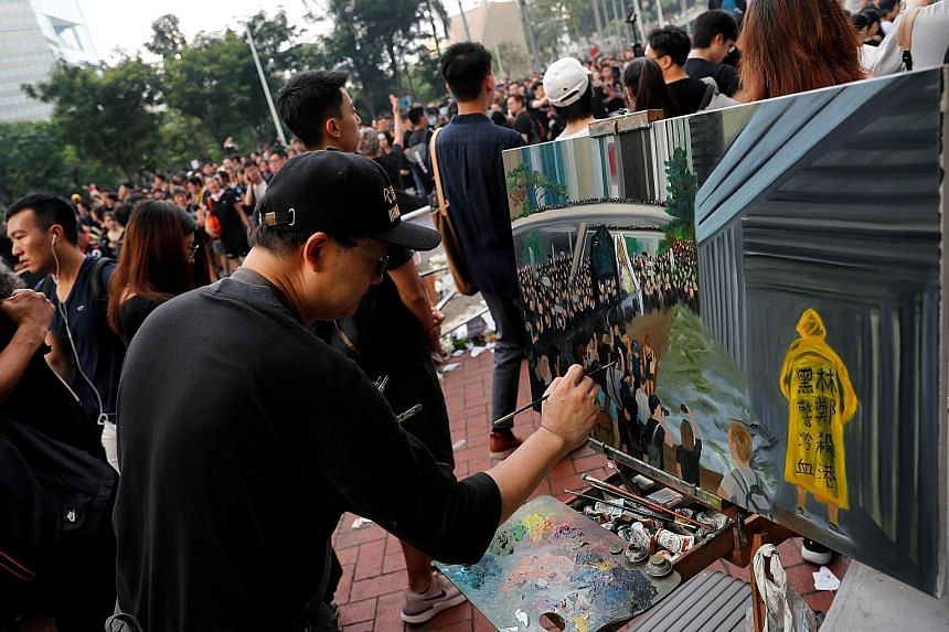 Mr Perry Dino working on a painting at a protest against the extradition Bill in Hong Kong on June 16. The 53-year-old artist says he considers it important to record what is happening in the Chinese-ruled city.