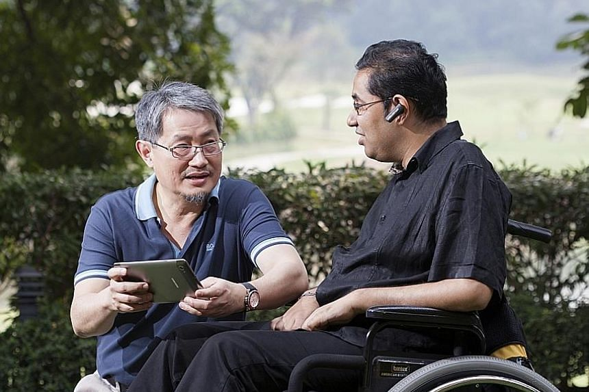 Founder Thomas Ng (far left) of Genashtim, a cloud-based digital solutions provider which hires people with disabilities, and employee Raj Kumar Selvaraj, a process manager.