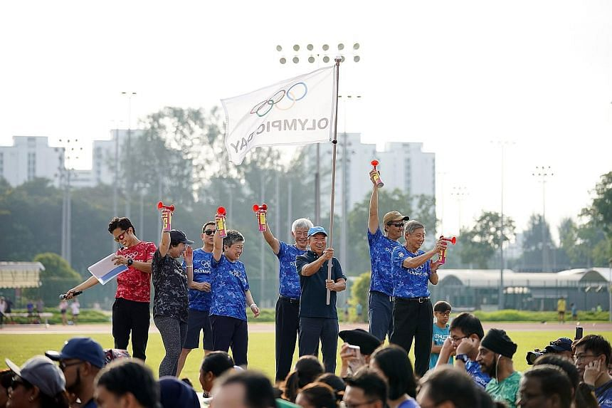 International Olympic Committee executive board member and Singapore Olympic Foundation chairman Ng Ser Miang flagging off the Olympic Day Walk in celebration of the 2019 Olympic Day in conjunction with the Singapore Tennis Festival yesterday. More t