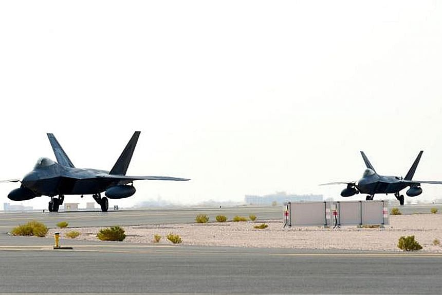US Air Force F-22 Raptors arriving at Al Udeid Air Base in Qatar on Thursday. Last month, the air force deployed several nuclear-capable B-52 bombers to the Gulf in response to what the Defence Department described as a possible plan by Iran to attac