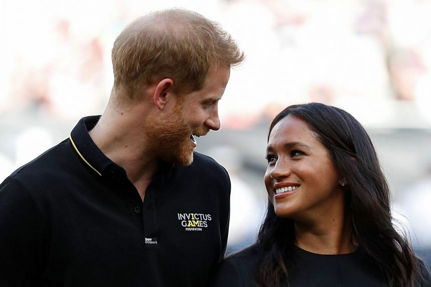 Harry and Meghan arrive on the field prior to the start of the first of a two-game series between the New York Yankees and the Boston Red Sox.