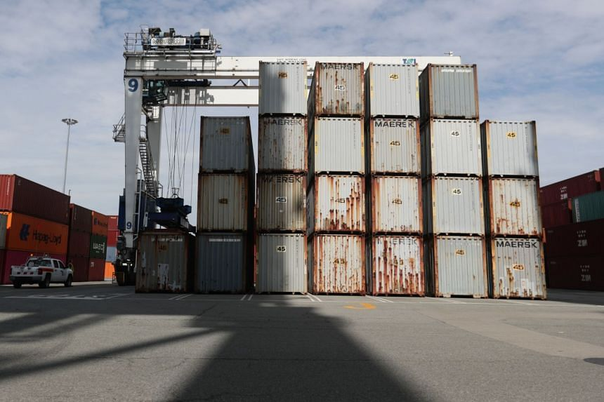 Shipping containers filled with garbage are loaded on to trucks and stacked for holding in Canada on June 29, 2019.