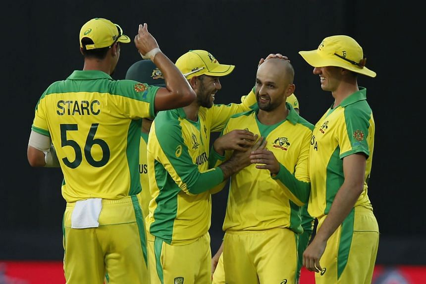 Australia's Nathan Lyon celebrates making the catch off his own bowling to take the wicket of New Zealand's James Neesham for nine.
