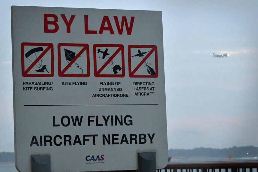 A sign at Changi Beach warning against the flying of drones and other activities that would compromise safety at the nearby Changi Airport.