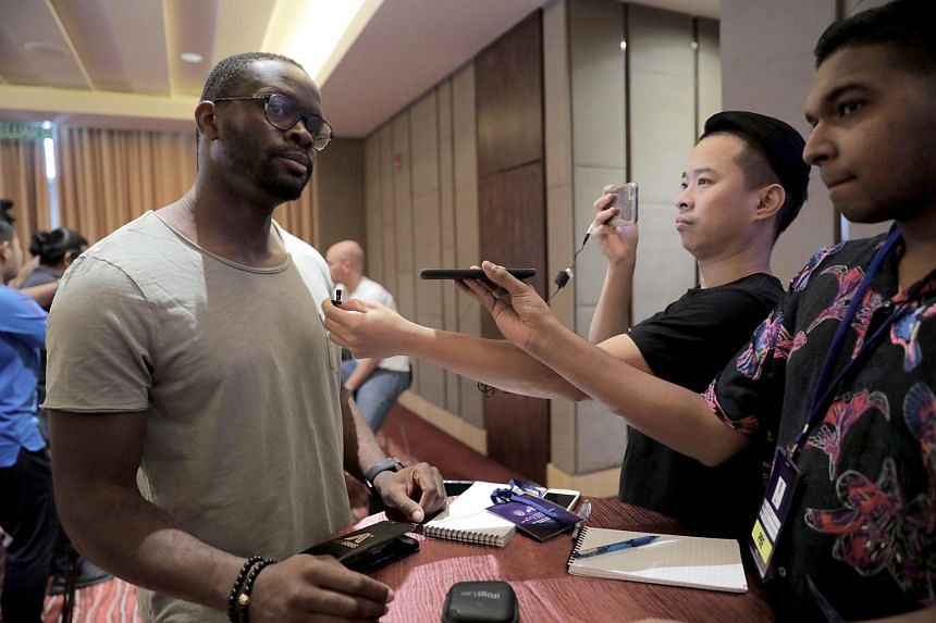 Former Manchester United player Louis Saha speaking to members of the media in Johor Bahru on June 30, 2019.