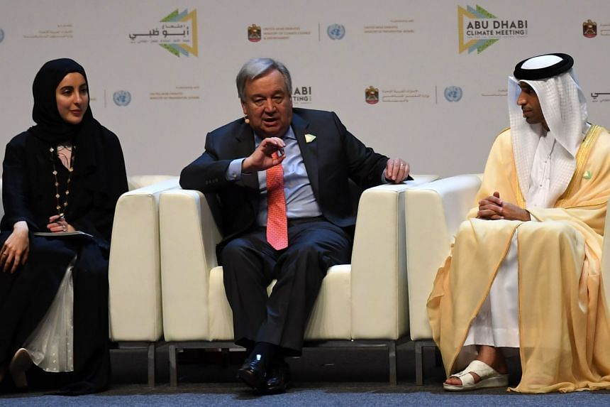 UN chief Antonio Guterres (centre), flanked by UAE Minister of State for Youth Affairs Shamma al-Mazrui (left) and UAE Minister of Climate Change Thani al-Zeyoudi, speaking at the Abu Dhabi climate meeting Summit on June 30, 2019.