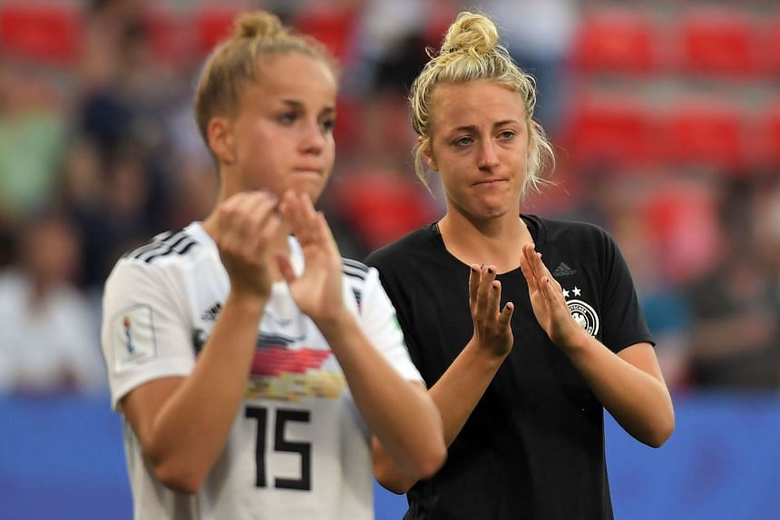 German players react at the end of the match.