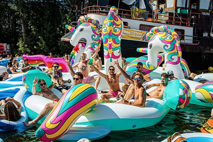 People enjoy a hot summer day on inflatable boats during the Utrecht Drijf event in The Netherlands.