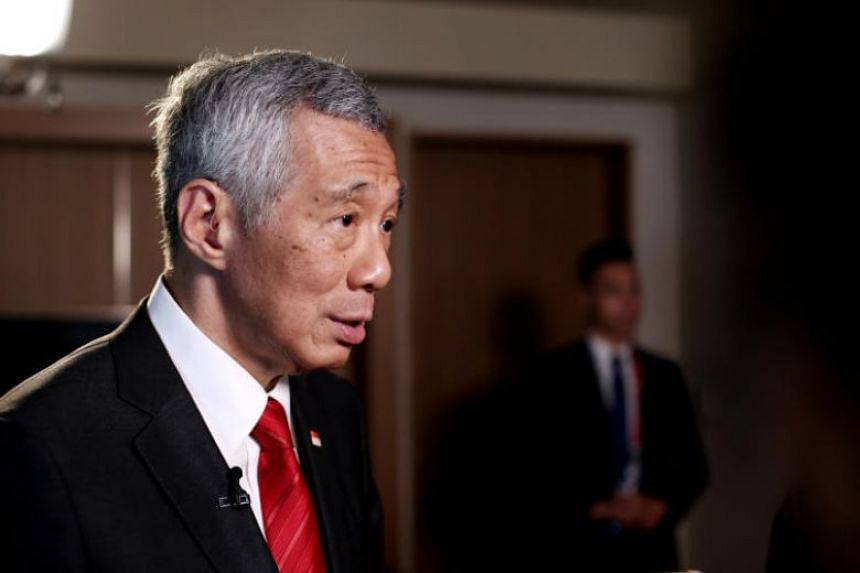 Prime Minister Lee Hsien Loong speaking to Singapore reporters at the end of the two-day Group of 20 Leaders' Summit in Osaka, Japan, on June 29, 2019.