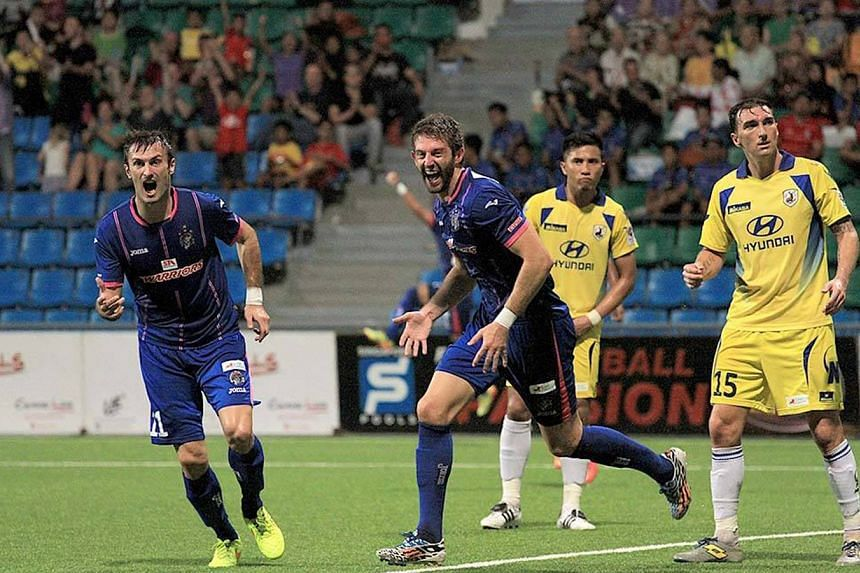 Mr Beattie (second from left) was playing for Warriors FC when he suffered a career-ending injury in 2015. Mr Thomas Beattie is now the owner of 11 businesses which are expected to bring in $10 million in revenue this year.