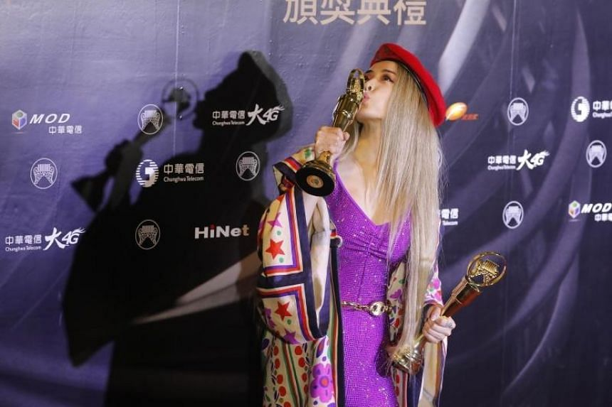 Taiwanese singer Jolin Tsai poses with her trophies after winning the Song of the Year and Album of the Year at the Golden Melody Awards in the Taipei on June 29, 2019.