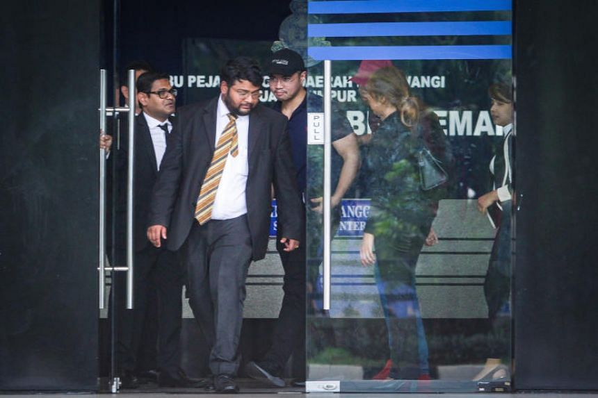 Mr Haziq Abdullah Abdul Aziz (centre) being released on bail from the Dang Wangi District Police HQ in Kuala Lumpur on June 15, 2019.