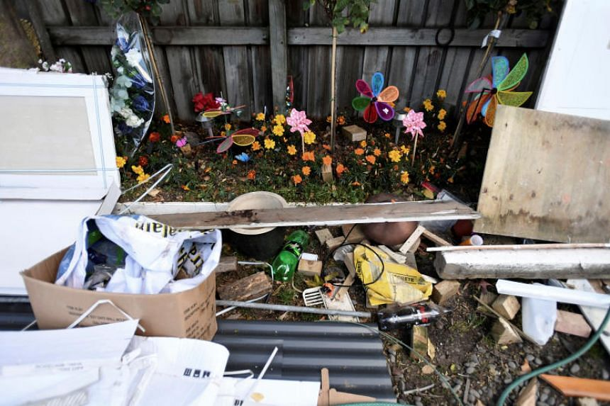 Flowers that were left in remembrance are planted in a garden to grow among the debris from renovations at the Linwood Mosque in Christchurch, New Zealand, on April 25, 2019.