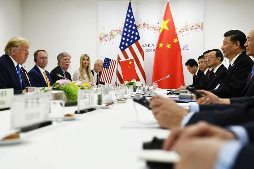 US President Donald Trump talks with China's President Xi Jinping in their bilateral meeting on the sidelines of the G-20 Summit in Osaka on June 29, 2019.