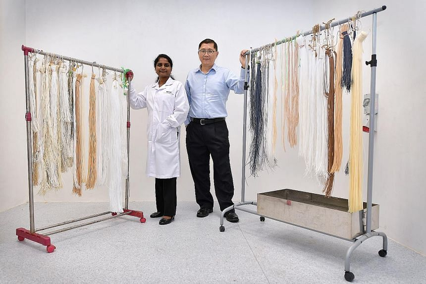 Dr Sowrirajalu Bhuvana (left), senior manager of technology with the Environmental and Water Technology Centre of Innovation at Ngee Ann Polytechnic, helped Firmbase's Pung Choong Theng develop a water membrane that does not clog up easily.