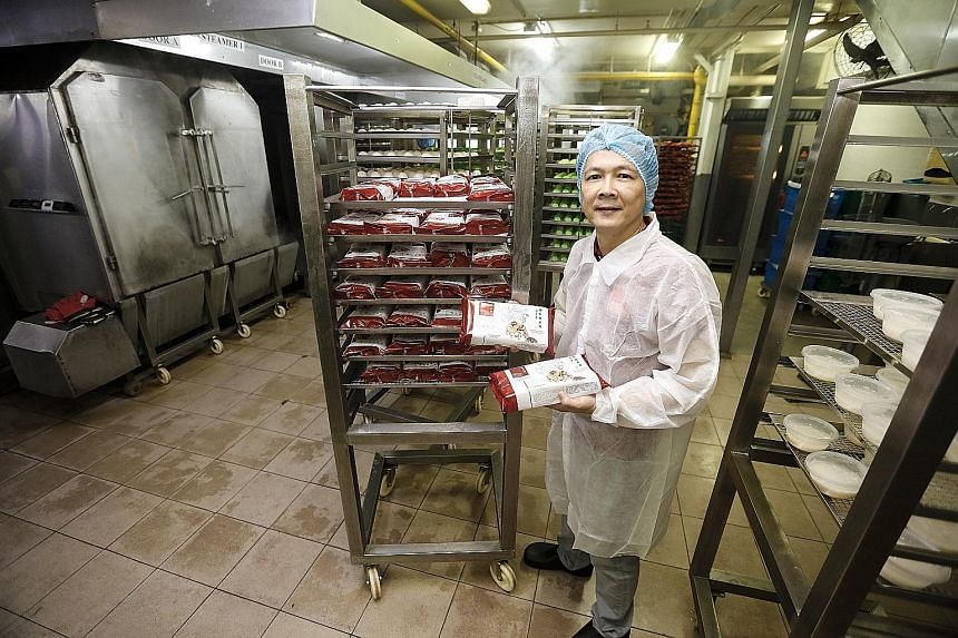SMH Food operations director Johnson Tay with his firm's ready-to-eat lor mai kai dish. Six months of experiments with the Food Innovation and Resource Centre resulted in a shelf-stable product that can be exported.
