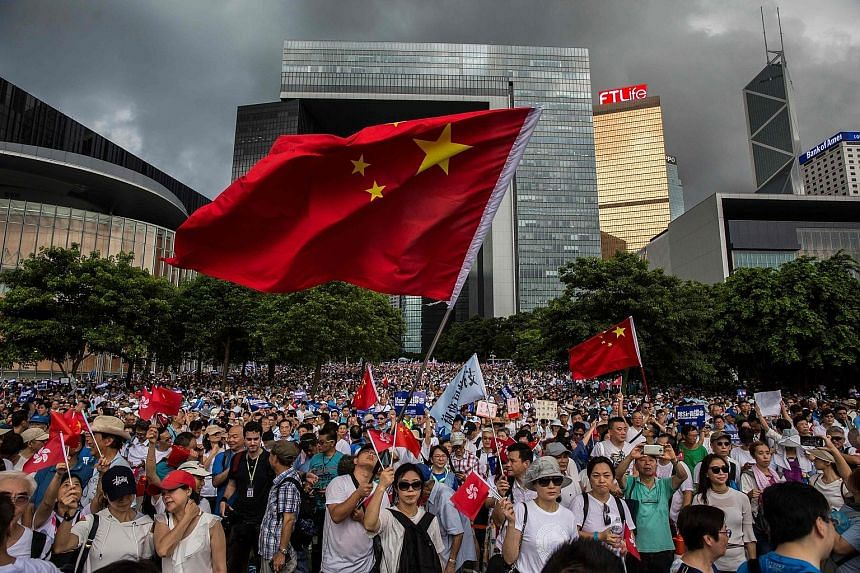 Demonstrators rallying in support of the police outside the Legislative Council in Hong Kong yesterday. The city's administration, led by Chief Executive Carrie Lam (above), is in a deadlock with protesters over a proposed controversial extradition l