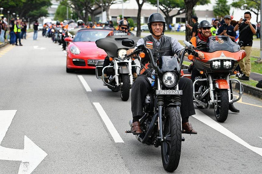 Mr Mohamed Abdullah Alhabshee, President Halimah Yacob's husband, cruising on a bike sponsored by Harley-Davidson of Singapore, at the outdoor carpark near Kallang Leisure Park yesterday. More than 700 motorcyclists - some from Malaysia and Brunei -