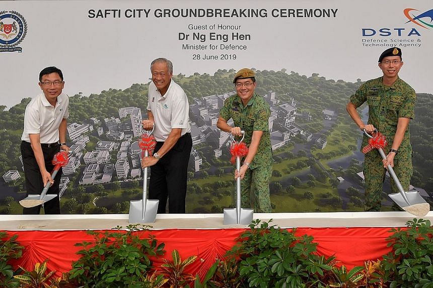 Defence Minister Ng Eng Hen with (from left) Defence Science and Technology Agency chief executive Tan Peng Yam; Chief of Defence Force, Lieutenant-General Melvyn Ong; and Chief of Army, Major-General Goh Si Hou, doing the symbolic sod-turning for th