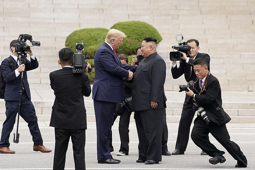 US President Donald Trump with North Korean leader Kim Jong Un on North Korea's side of Panmunjom truce village in the Demilitarised Zone. Mr Trump walked a few steps across the North Korean border and posed for photos, making him the first US presid