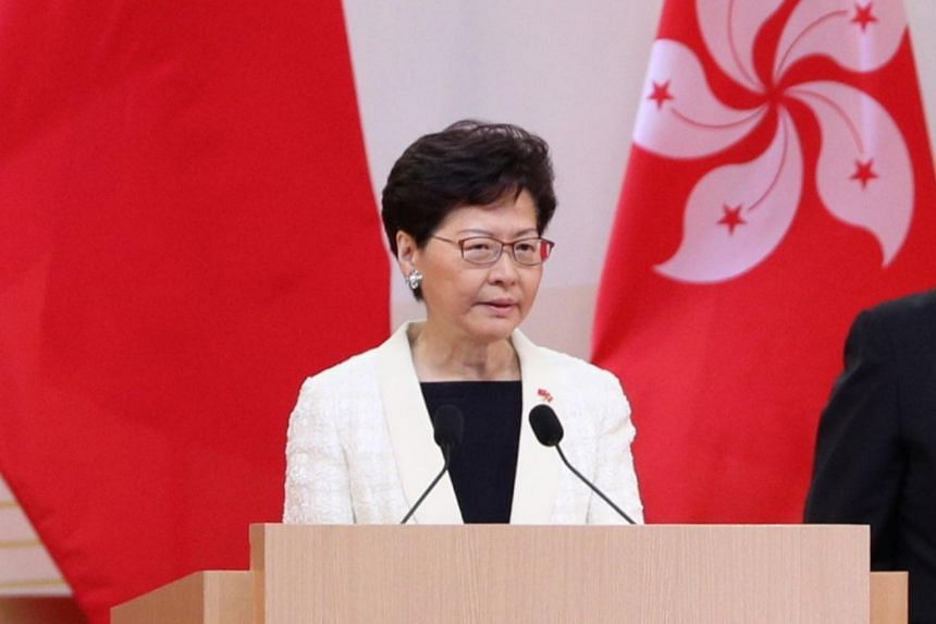 Hong Kong Chief Executive Carrie Lam speaks after the annual flag-raising ceremony to mark the 22nd anniversary of the handover from Britain to China, at the Hong Kong Convention and Exhibition Centre on July 1, 2019.