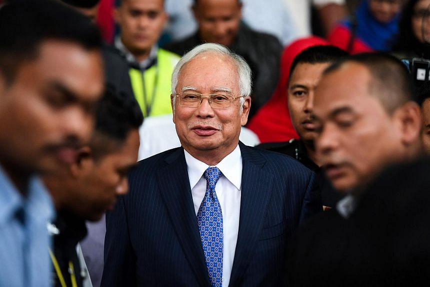 Malaysia's former prime minister Najib Razak leaves court in Kuala Lumpur on April 3, 2019. He was refused a request to skip a day in court to attend Parliament on July 1, 2019.