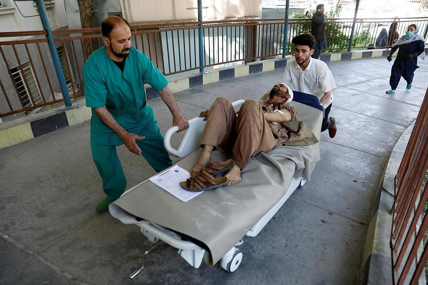 An injured man is transferred to a hospital after a blast in Kabul, Afghanistan, on July 1, 2019.