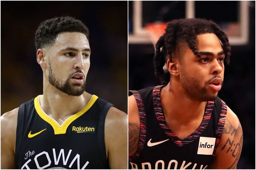 Golden State Warriors shooting guard Klay Thompson (left) will stay with the team, while D'Angelo Russell is expected to join the Warriors as well.