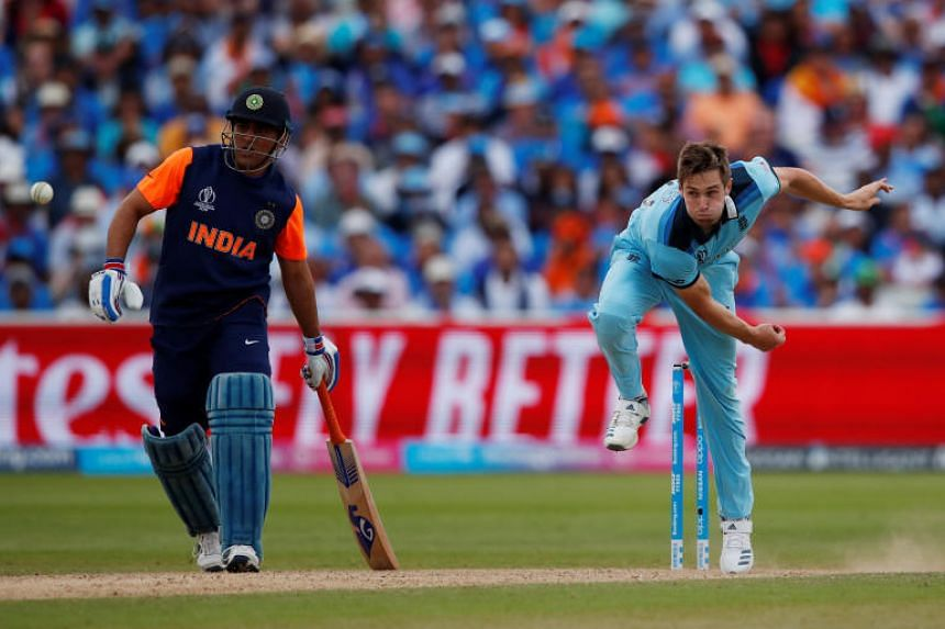 England's Chris Woakes in action.