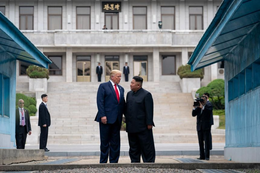 US President Donald Trump stands with Kim Jong Un, the North Korean leader, on the North Korean side of the Demilitarized Zone at Panmunjom, on June 30, 2019.