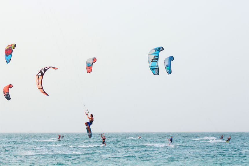 Let the wind sweep you away with kitesurfing in the Arabian Gulf. PHOTO: TOURISM DUBAI
