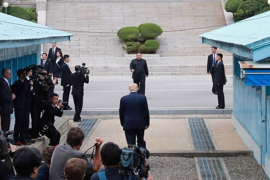 US President Donald Trump and North Korean leader Kim Jong Un meet at a military demarcation line at the DMZ in Panmunjom, South Korea, on June 30, 2019.