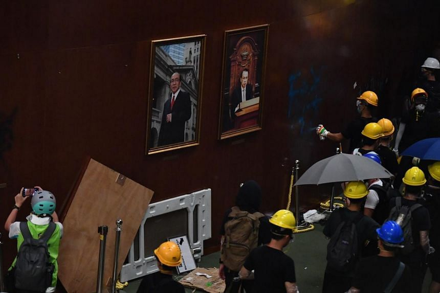 Protesters vandalising the walls of the Legislative Council building after breaking in on July 1, 2019.
