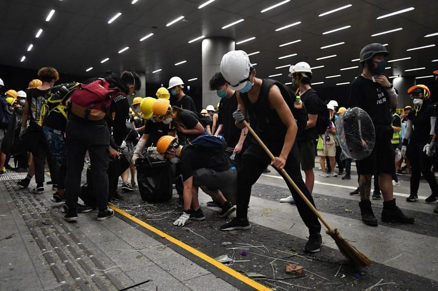 Protesters cleaning up after they stormed into the Legislative Council Complex on July 1, 2019.