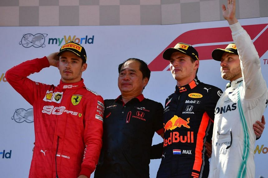 (From left) Ferrari's Monegasque driver Charles Leclerc, Toyoharu Tanabe, F1 Technical Director of Honda, Red Bull Racing's Dutch driver Max Verstappen and Mercedes' Finnish driver Valtteri Bottas stand on the podium after the Austrian Formula One Gr
