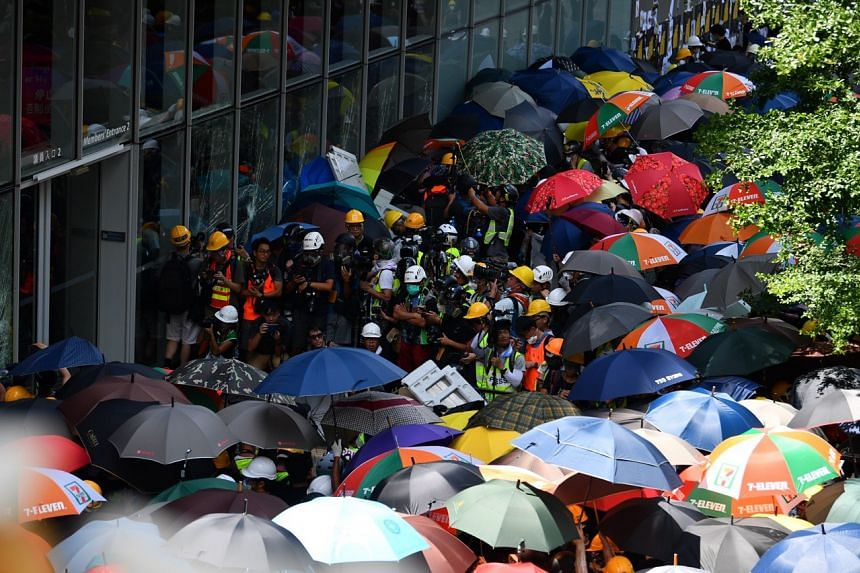 Protesters prepare to storm the Legislative Council building in Hong Kong on July 1, 2019.
